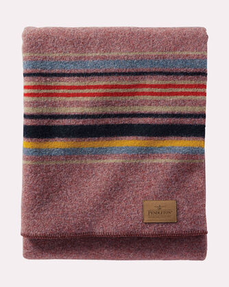 Rugged enough for the campground or a kids' living room fort, the Pendleton Yakima wool blanket provides a generous layer of warmth wherever you need it. Available at REI.