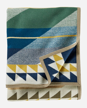FOLDED VIEW OF FOSSIL SPRINGS BLANKET IN CREAM