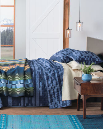 ADDITIONAL VIEW OF SIERRA PRINTED QUILT SET IN BLUE