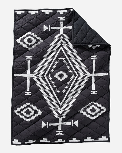 LOS OJOS QUILTED ROLL-UP THROW IN BLACK/IVORY