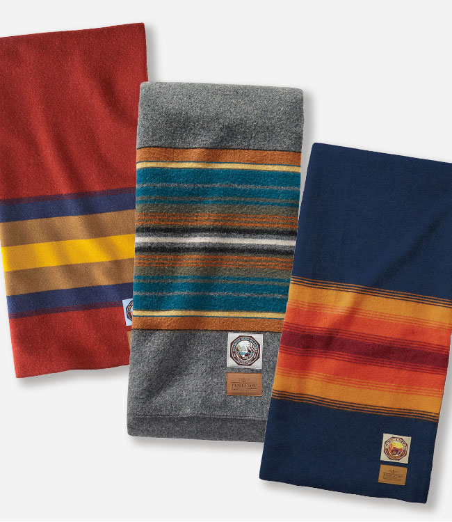 Three striped, folded National Park blankets