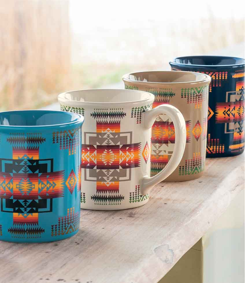 Four multi-color mugs in the Chief Joseph pattern