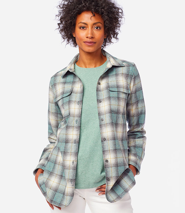 Standing woman in a teal plaid Board Shirt
