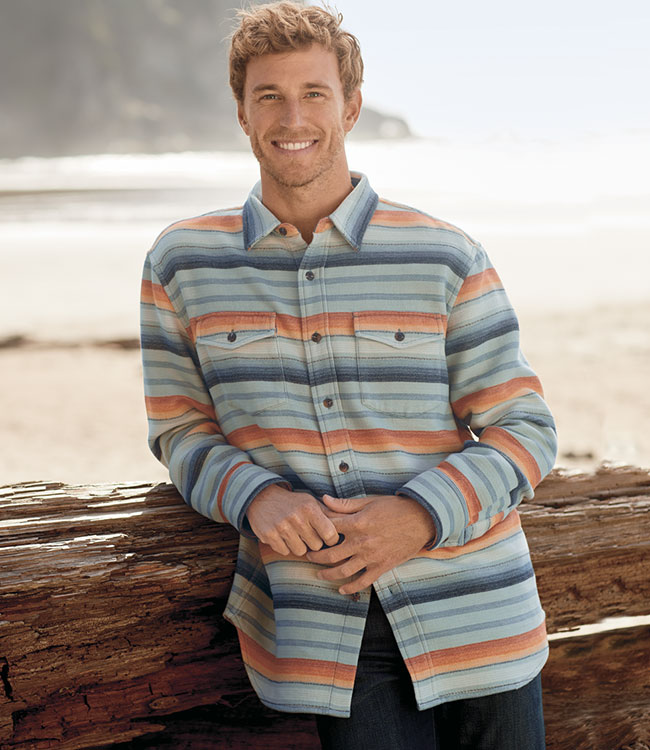 Standing man wearing a blue stripe Serape Beach men's shirt