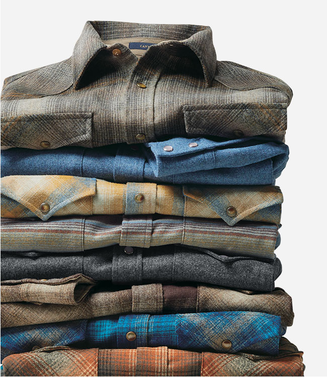 Stack of plaid men's wool shirts