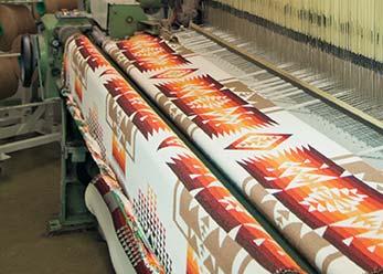 Photo of Mill Loom Weaving Fabric
