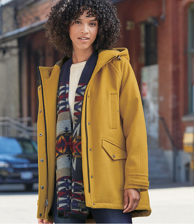 Woman in a city wearing a West Haven Insulated Jacket in yellow