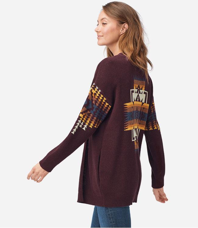 Woman wearing a burgundy cardigan sweater
