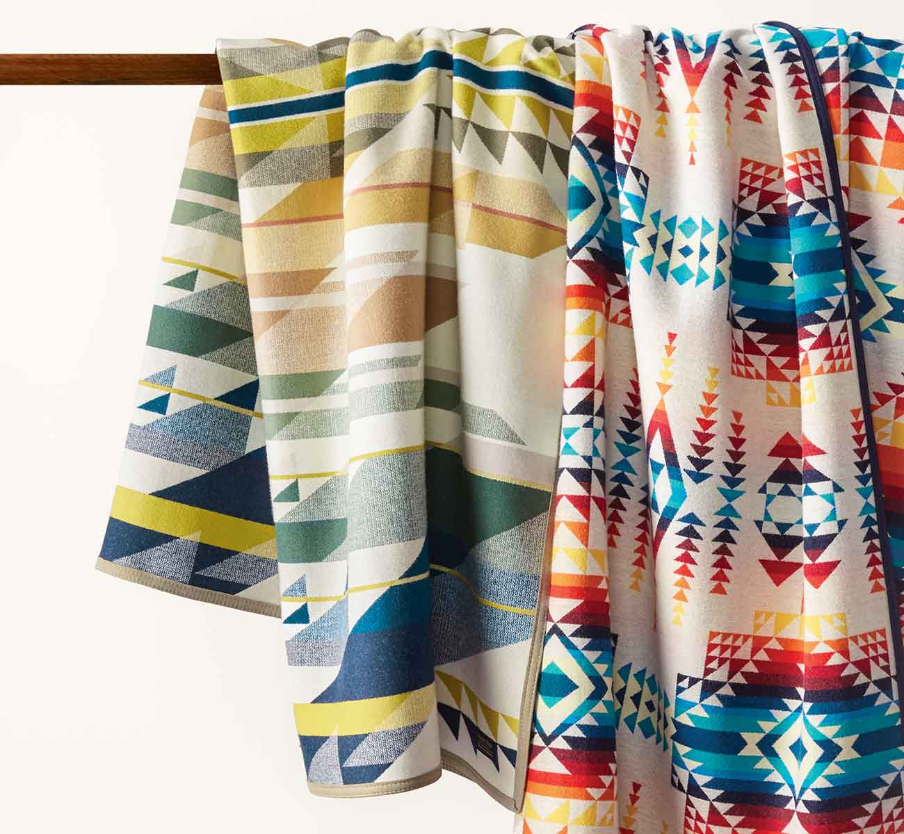 Two hanging patterned wool blankets