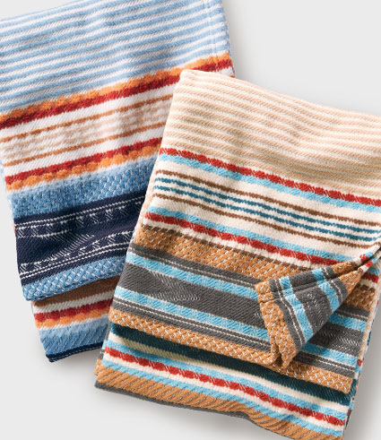 Two folded striped cotton throw blankets