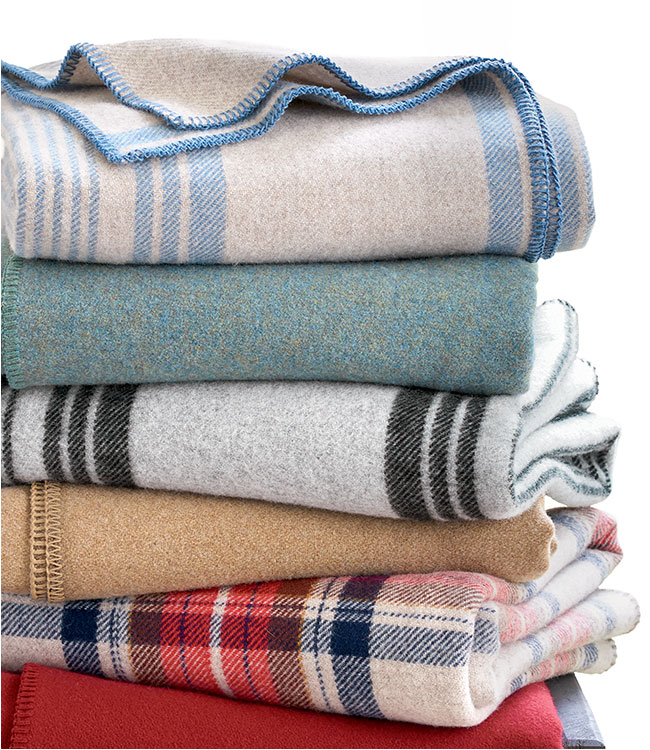 Stack of Plaid and Solid Wool Blankets