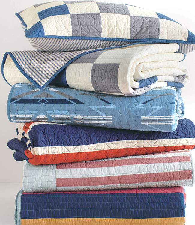 Stack of folded cotton quilts