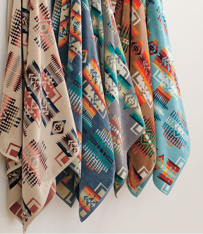 Hanging Chief Joseph Beach Towels in a variety of bright colors
