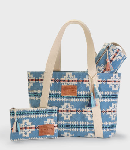 A large tote bag and zip pouch in the blue Chief Joseph pattern