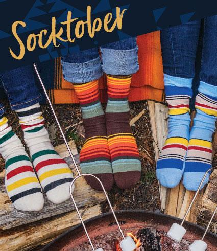 <Pendleton stripes socks on feet around a campfire