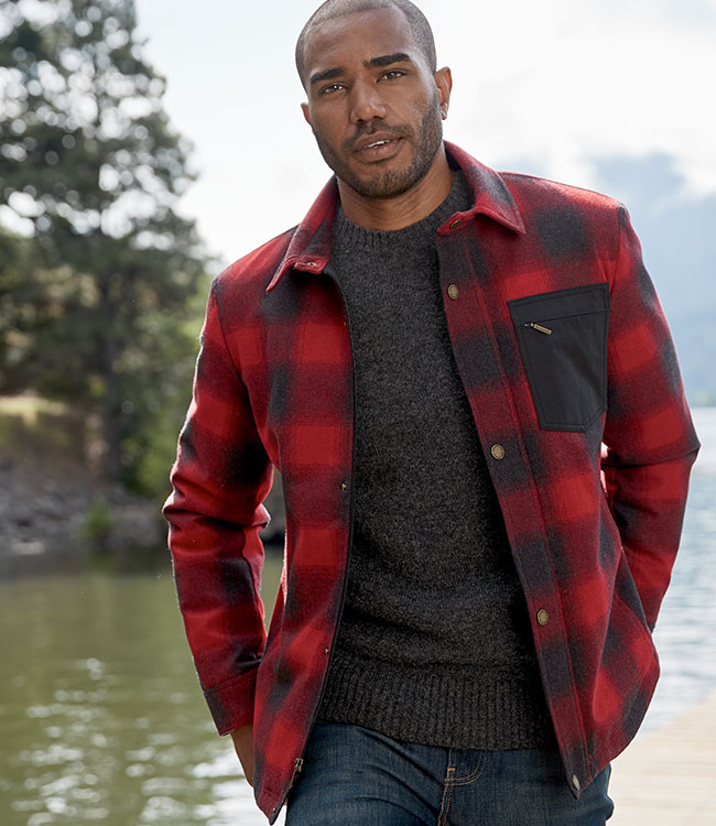 Model wearing a red and black wool Conway Jacket