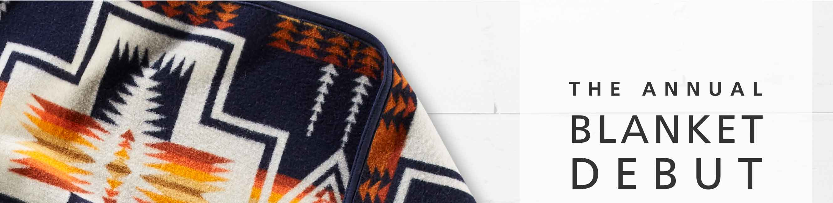 THE ANNUAL BLANKET DEBUT, featuring a navy geometric Harding patterned blanket